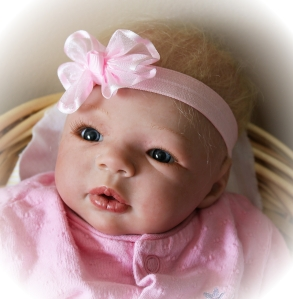 "A reborn doll crafted at "" Until Forever Nursery"" operated by doll artists Kathi George and Julie Crosier"